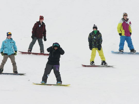 Snowboarders at Sleepy Hollow Sports Park in Des Moines.