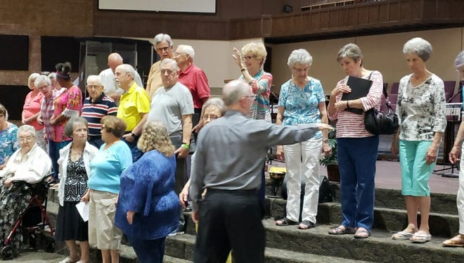 Larry Shields directs The Faith Singers at Faith Baptist Church. The senior adult choir, comprised of retired men and women over 50, brings smiles and joy to residents in nursing and retirement homes through good old fashioned gospel music.