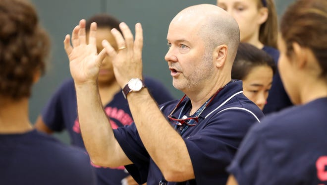 Pelham High School volleyball coach Mark Finegan talks with his team during a scrimmage against Yorktown High School at Yorktown High School, Aug. 29, 2017.