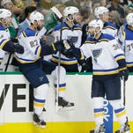 St. Louis Blues right wing Troy Brouwer (36) celebrates scoring a goal with Alex Pietrangelo (27), Carl Gunnarsson (4) and other teammates on the bench during the first period of Game 2 of the NHL hockey Stanley Cup Western Conference semifinals against the Dallas Stars, Sunday, May 1, 2016, in Dallas.