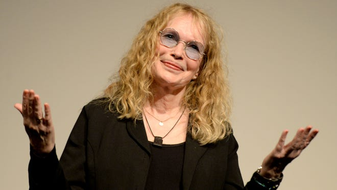"Mia Farrow gestures as she receives the ""Leopard Club Award"" at the 67th Locarno International Film Festival in Locarno Switzerland on Aug. 8, 2014. Farrow, 69, has returned to Broadway for the first time in 16 years to perform in A.R. Gurney's play ""Love Letters,"" in which would-be lovers read aloud letters exchanged over a lifetime."