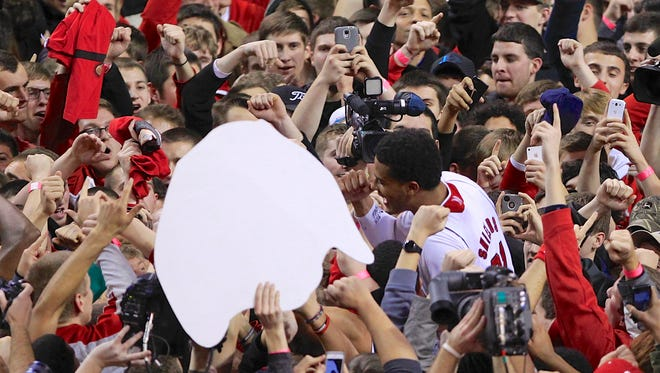 Nebraska's Shavon Shields (31), center right, is carried on shoulders after Nebraska's 68-62 win over Ohio State in an NCAA college basketball game in Lincoln, Neb., Monday, Jan. 20, 2014. (AP Photo/Nati Harnik)
