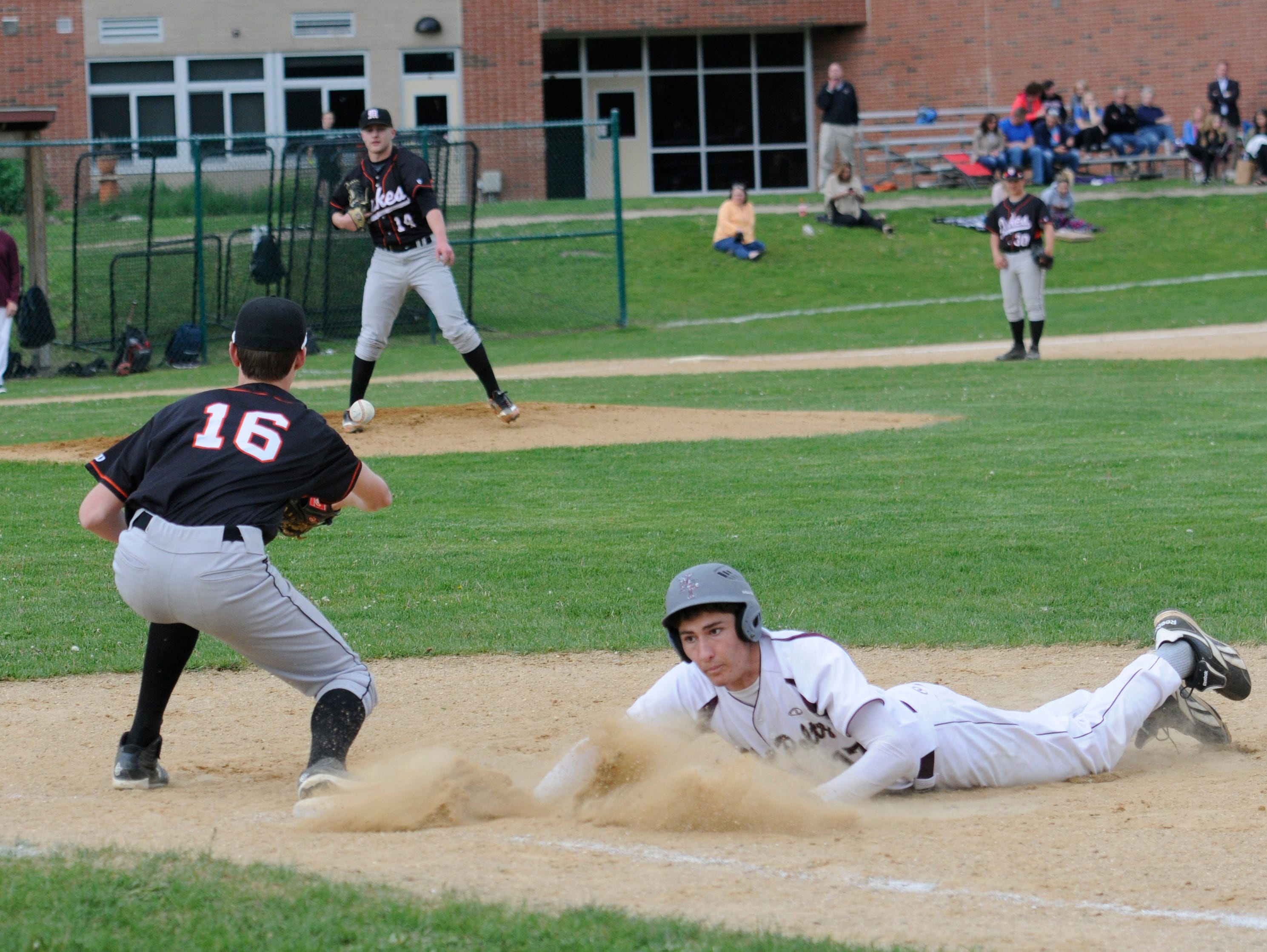 New Paltz's Adam Stolfe slides back to first base as Marlboro's Jack Rusk prepares to catch the ball from Nick Mongelli during Tuesday's game at New Paltz.
