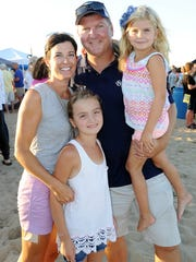 Steve Montgomery with wife Dee Dee and children Savannah and Brooklyn at Dewey Beach Business Partnership's end -of-the-year beach party.