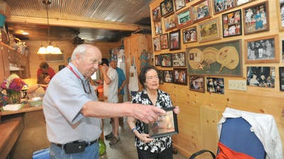 Snooky Williams of Water Valley, left, and his wife, Mary Lou, talk in their cabin on opening day of the 2013 Neshoba County Fair. The 2014 fair started today.