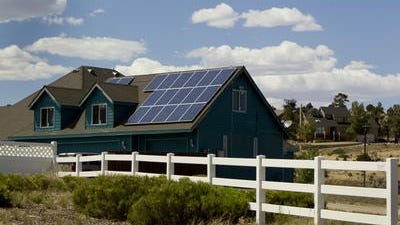 APS installed solar panels on 125 homes in Flagstaff. APS owns and maintains the panel and the homeowners lower their electric bill. The utility would like to roll out a similar program in Phoenix.
