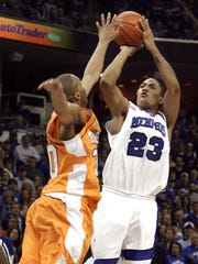 Memphis guard Derrick Rose (23) shoots over the reach of Tennessee's J.P. Prince, left, in the first half of a game Feb. 23, 2008, in Memphis. Rose led Memphis with 23 point but the top-ranked Tigers lost to Tennessee 66-62.