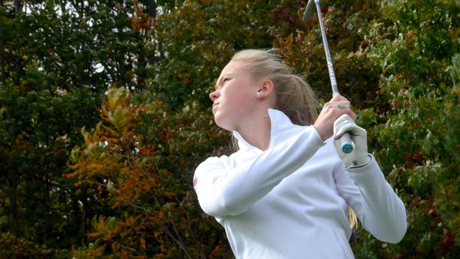 Holland Christian's Ainsley VandenBrink is working on her approach shots this season.