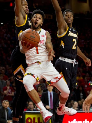 Maryland's Jaylen Brantley goes to the basket as Towson's Justin Gorham, left, and Jordan McNeil try to block in the second half.