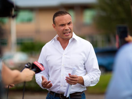 Republican congressional candidate Dan Bongino speaks during a news conference he held in front of the Naples Daily News on Monday, Aug. 22, 2016, in North Naples. Bongino spoke about his recent exchanges with reporters and declined to participate in an election forum being held afterward at the Daily News.