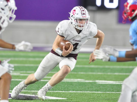 Brownwood quarterback Tommy Bowden runs in the open field during the Lions' 44-34 loss to Wichita Falls Hirschi in a Region I-4A bi-district playoff Friday at Abilene Christian University's Wildcat Stadium.