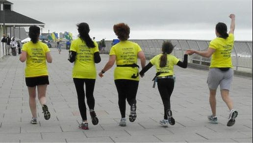 Runners representing the Central  N.J. Brain Tumor Support Group at a past New Jersey Marathon in Long Branch.