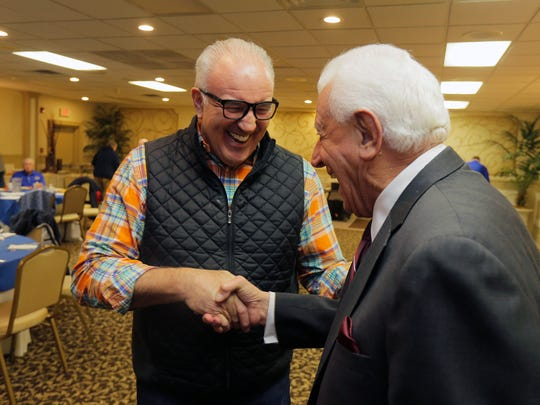Former heavyweight contender Gerry Cooney talks to Tony Tamburello of Tinton Falls before speaking at the monthly breakfast of the Jersey Shore Sports Alumni in Ocean Township.