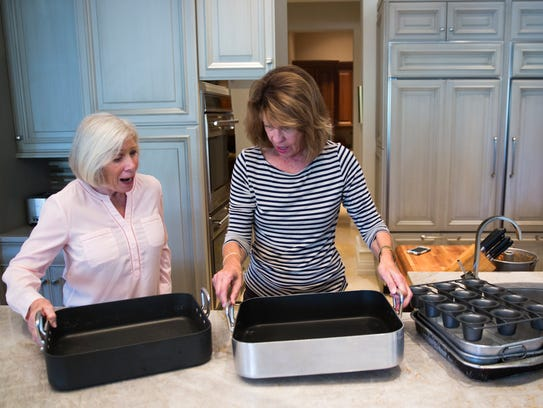 Pat Gibbons and party planner Pam Beckman pull pots