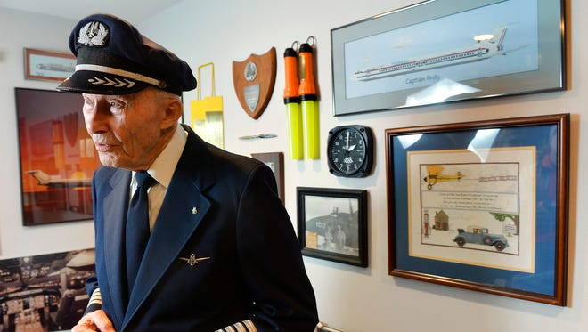 Aviation art and memorabilia surround retired American Airlines pilot Andy Anderson as he talks Wednesday, April 6, in his St. Cloud home.