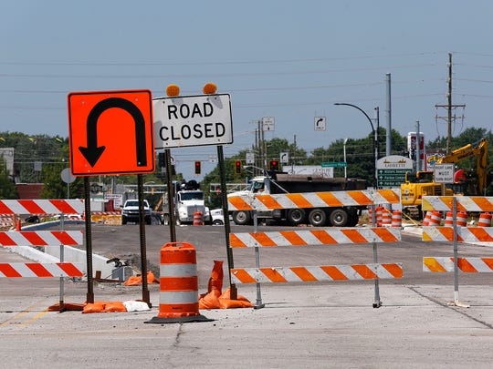 Road blocks in place on South Street just east of the intersection with Sagamore Parkway Friday, July 13, 2018, in Lafayette. The intersection of South Street and Sagamore Parkway is set to open on Saturday, July 14.