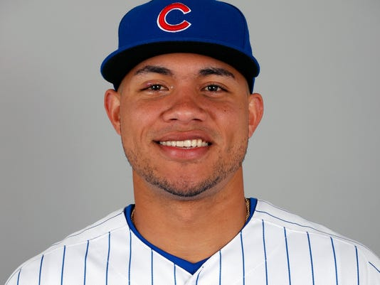 FILE - This is a Feb. 20, 2018, file photo showing Willson Contreras of the Chicago Cubs baseball team. In his first full season in the majors, Contreras established himself as one of baseball's top catchers and earned respect as a leader behind the plate for the Cubs. He comes into this season with a chance to solidify himself as one of the top players on one of the top teams. (AP Photo/Charlie Neibergall, File0