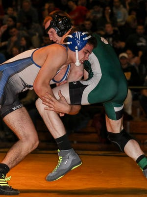 Jeff Johnson of Middlesex-Dunellen, left, wrestles South Plainfield'sKyle Bythell at 138 lbs. in the GMC Wrestling Tournament finals at Piscataway High School on January 30, 2016.