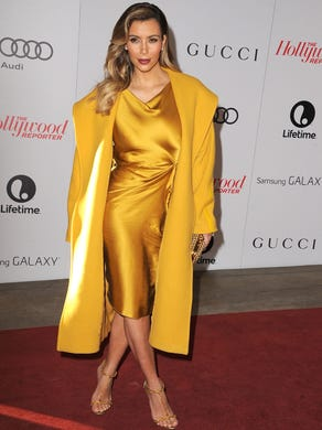 Kardashian arrives at the The Hollywood Reporter's Women In Entertainment breakfast, which honored Oprah Winfrey, in Beverly Hills on Dec. 11, 2013. Mom Kris was there, too.