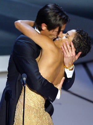 Adrien Brody kisses Halle Berry as he accepts his Oscar  at the 2003 Academy Awards ceremony.