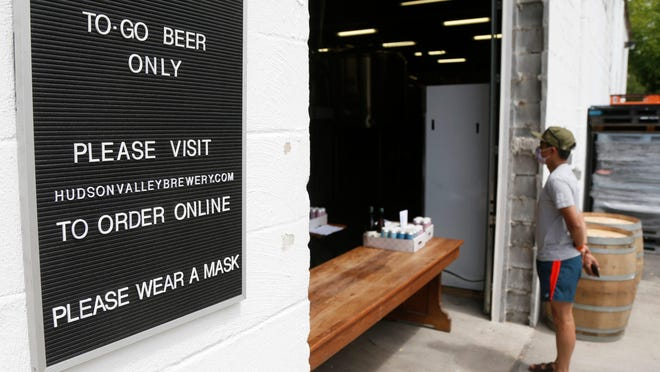 A sign describing the process to pick up online orders at Hudson Valley Brewing in Beacon on May 22.