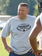 Warriors' football coach Jason Foster coaches during