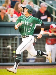 Parkside shortstop Connor Shockley (9) scores a run