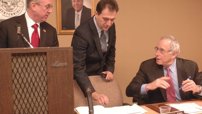 In this 2011 file photo, then-Mayor Parisi, Borough Attorney Fred Semrau, and Ilan Plawker discuss town business.