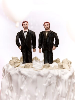 Same-sex wedding cake topper.