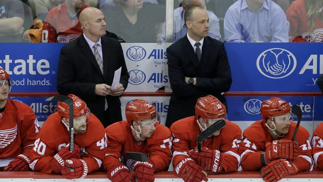 Red Wings assistant coach Pat Ferschweiler, left, and head coach Jeff Blashill watch during the third period of an NHL hockey game against the Oilers on Nov. 27, 2015, in Detroit.