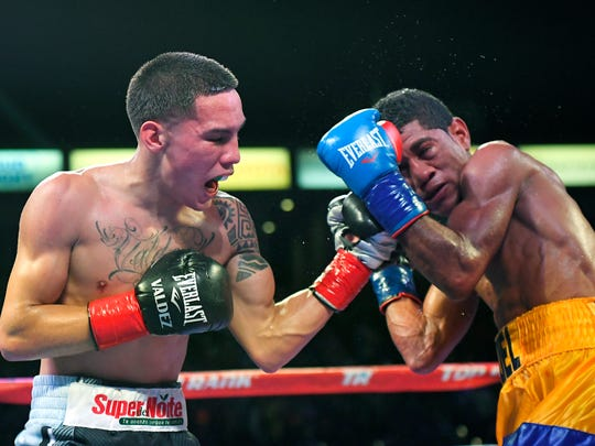 Oscar Valdez, Jr., left, of Mexico, connects with Miguel Marriaga, of Colombia, during a WBO featherweight world championship bout, Saturday, April 22, 2017, in Carson, Calif. (AP Photo/Mark J. Terrill)