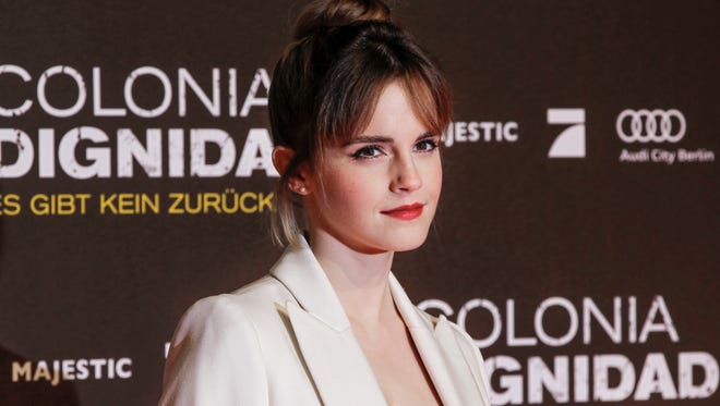 Emma Watson says her next year will be spent reading and listening instead of acting.