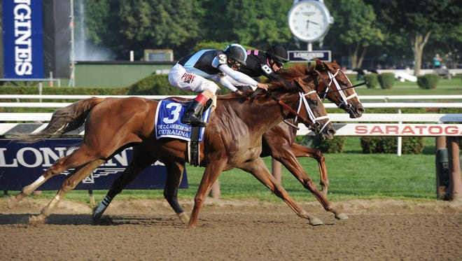 I'm a Chatterbox (on rail) nosed out Curalina in Saratoga's Coaching Club American Oaks but was disqualified to second for impeding Curalina. The two meet again in Saturday's $600,000 Alabama Stakes.