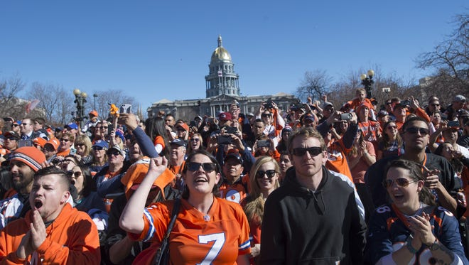 Fans cheer for the Broncos as they take the stage in Civic Center Park during a Super Bowl championship celebration in Denver on Feb. 9, 2016.
