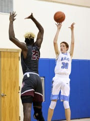Kevin Barry goes for the basket. On Monday, the Manta Rays' basketball team hosted top ranked First Baptist Academy at the Marco Island Charter Middle School gymnasium.