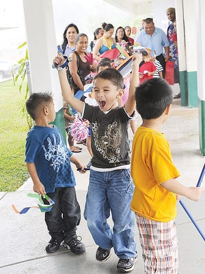 In this Oct. 5, 2011, file photo, students in the Head Start program at Maria Ulloa Elementary School parade through the school grounds.