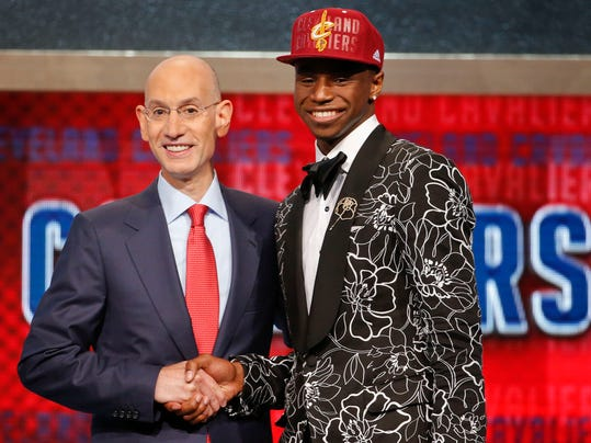 NBA Commissioner Adam Silver, left, congratulates Andrew Wiggins of Kansas who was selected by the Cleveland Cavaliers as the number one pick in the 2014 NBA draft, Thursday, June 26, 2014, in New York. (AP Photo/Jason DeCrow)