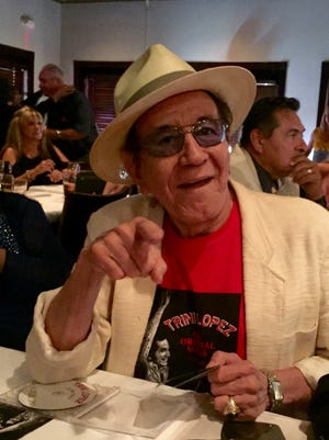 Trini Lopez greets friends and fans at his CD release party Sunday at the Palm House restaurant in Palm Springs.