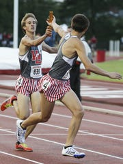 West Lafayette's Dylan Williams makes the handoff to Jack Folkers during the 1,600 relay.