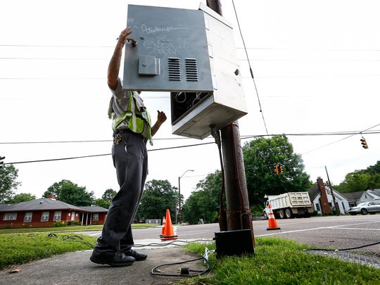 City of Memphis Traffic and Signal Technician Richard Camp works on getting stoplights at McLean and Vollintine repaired Thursday afternoon.