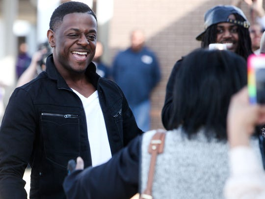 The Voice contestant and Monroe native Damien Lawson greets family and friends outside of his alma mater Wossman High School for a homecoming performance during the recent season.