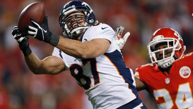 In this Dec. 1, 2013, file photo, Denver Broncos wide receiver Eric Decker makes a touchdown reception against the Kansas City Chiefs.