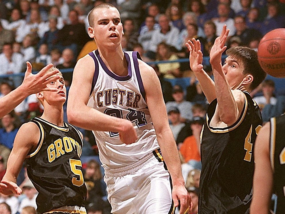 Derek Paulsen (center), a star player at Custer, was destined for great things at the Division-I college basketball level. Paulsen and his girlfriend, Eva Wahlstrom, were killed in a head-on car accident in 1999.