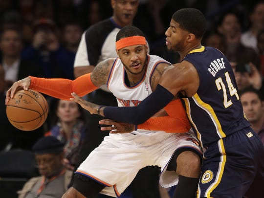 Will Carmelo Anthony, left, take less money to play in Chicago or take more money and hope Phil Jackson can build a winner in New York?
