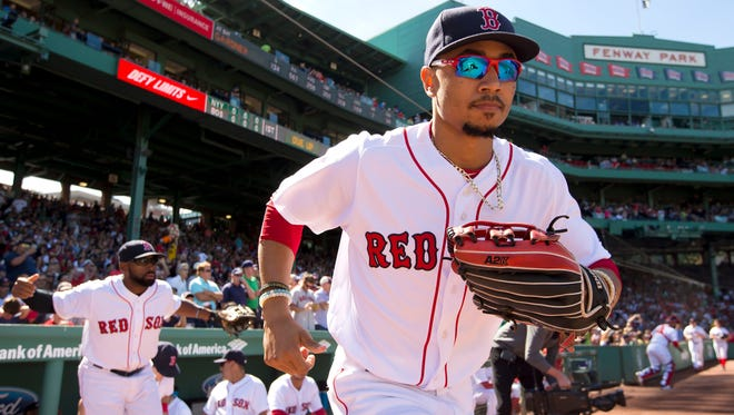 Boston right fielder Mookie Betts (50) takes the field before their game against the New York Yankees at Fenway Park. on Sept. 17, 2016.