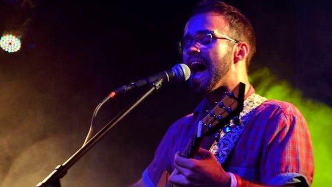 Singer/guitarist Carlos Barata singing at the Victory Club.