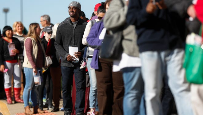 A line of early voters waits outside the Franklin County Board of Elections in Columbus, Ohio, the day before Election Day last year.