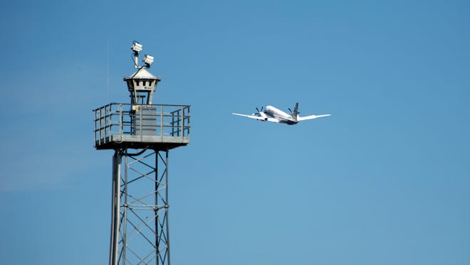 In this April 2015 photo provided by Saab AB, a plane takes off beyond a remotely controlled control tower at Ornskoldsvik Airport in northern Sweden.