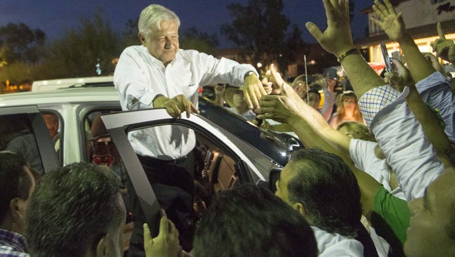 Andres Manuel Lopez Obrador is greeted by supporters.