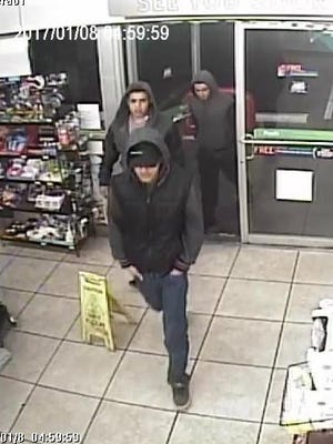 A video image capture shows three men suspected of stealing beer Jan. 8 at the 7-Eleven at 2000 N. Piedras St.